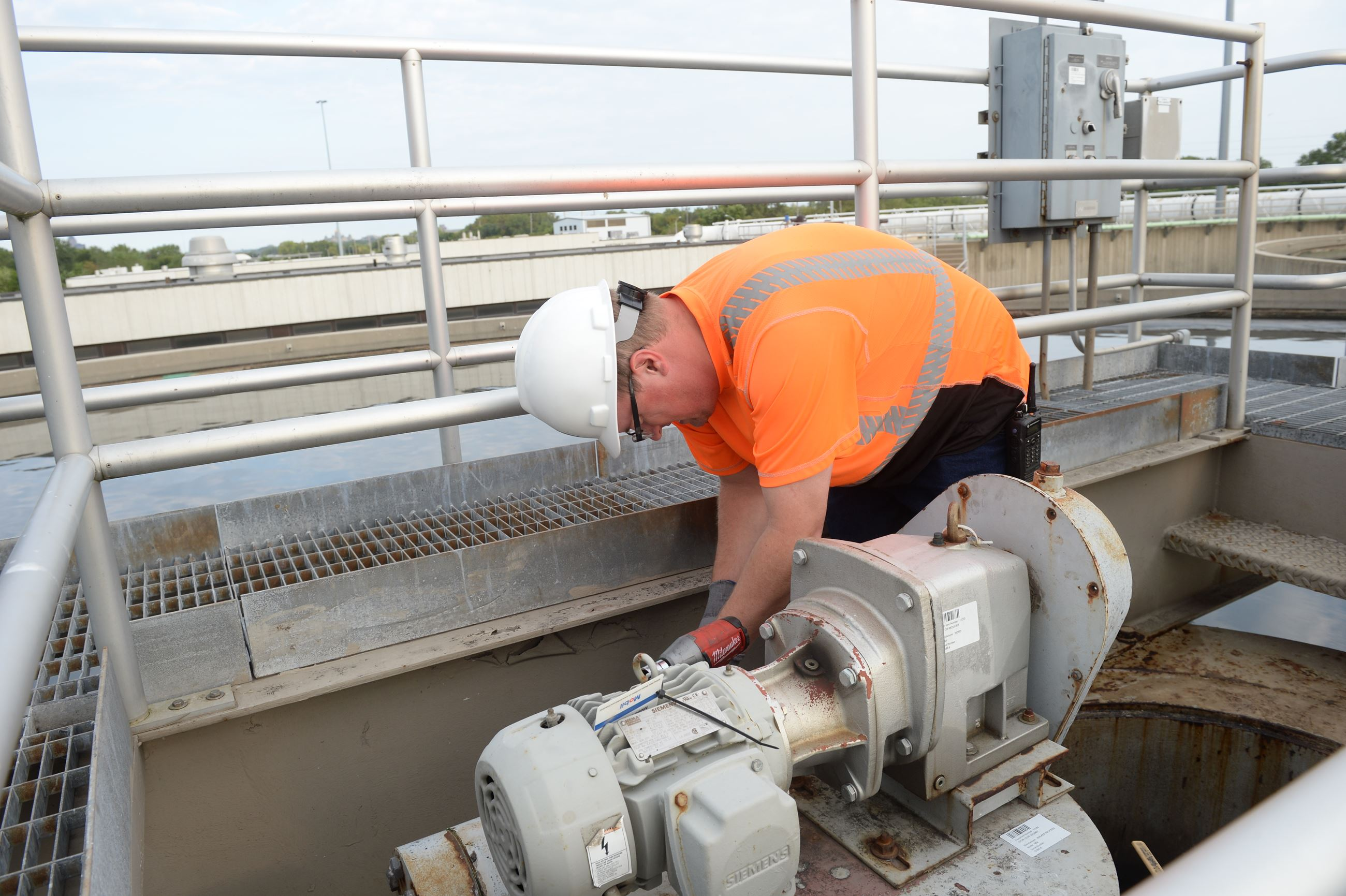 Employee Performing Preventive Maintenance